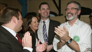 Sinn Fein candidate Pearce Doherty (centre) celebrates with his wife Roisin, Sinn Fein President Gerry Adams (right) and party colleagues at the election count in Donegal, 26 November 2010