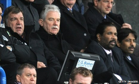 Sam Allardyce (left) watches from the stands along with Balaji Rao (second right) and Venkatesh Rao (right) of Venky's