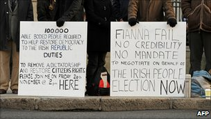 Protesters calling for an immediate general election, outside the prime minister's office in Dublin, Ireland, 26 November 2010