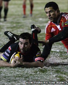 Tom Riley goes over for the Dragons' first try of the night