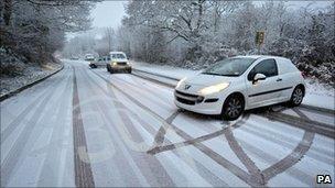 Car struggles to climb the hill on Penrhiwfer Road, Tonyrefail, Wales