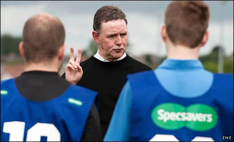 Hugh Dallas instructs new referees