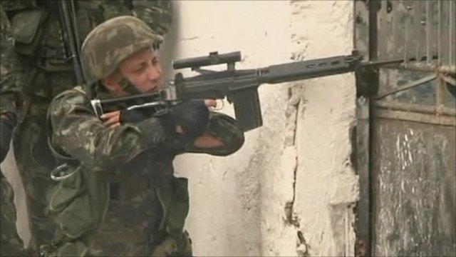 Soldier aiming gun