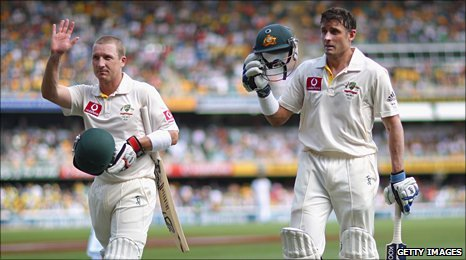 Brad Haddin and Michael Hussey leave the field at Brisbane