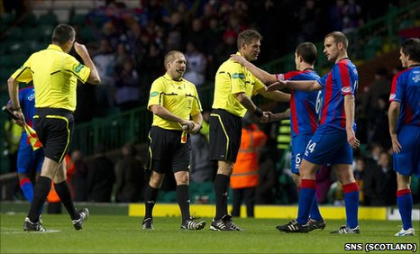 Inverness players shake hands with officials from Luxembourg