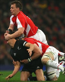 Wales captain Matthew Rees plays 'peek-a-boo' with New Zealand fly-half Dan Carter in Cardiff