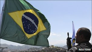 Brazilian flag and police officer