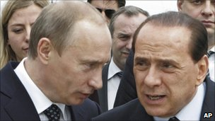Vladimir Putin (left) and Silvio Berlusconi