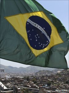 Brazilian flag flies over the Alemao favela
