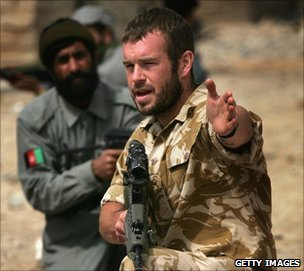 A British military policeman trains Afghan policemen on patrolling techniques in Kajaki in March 2006