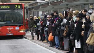A queue for a bus at Victoria station in London