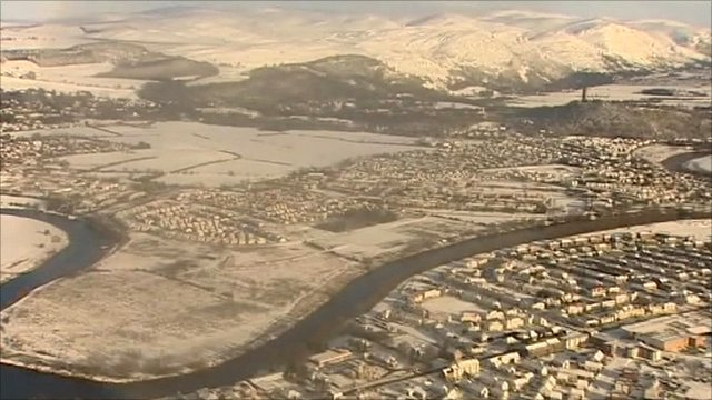 Aerial views of snowbound Scotland