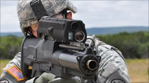 A US soldier holds the XM-25