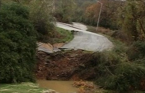 A road is destroyed by landslides in northern Greece