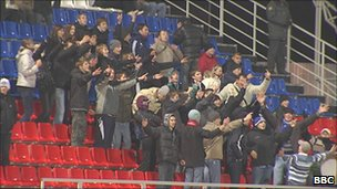 Fans of a local team in the football stadium in Saransk