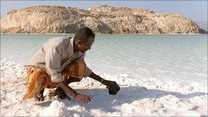 Ali Hamid mining salt by hand at Lake Assal, Djibouti