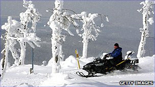 A German man on a snowmobile