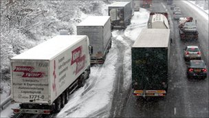 Lorries parked on the hard shoulder of the M25 in Surrey