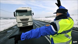 A gendarme orders a lorry-driver to park in Lempdes-sur-Allagnon, central France, 1 December.