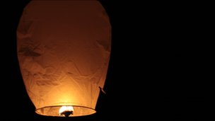 Sky lantern in a night sky