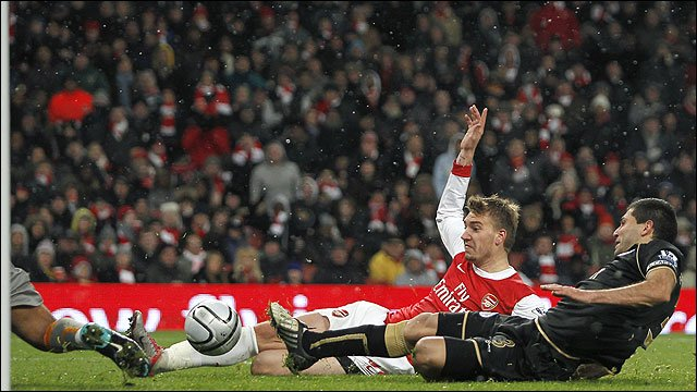 Nicklas Bendtner scores for Arsenal against Wigan Athletic