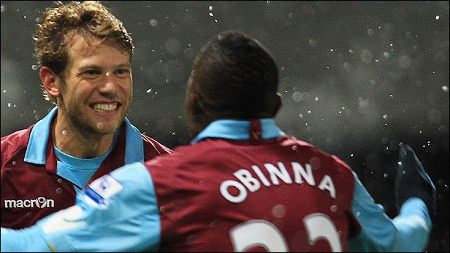 West Ham United celebrates scoring in their 4-0 Carling Cup against Manchester United