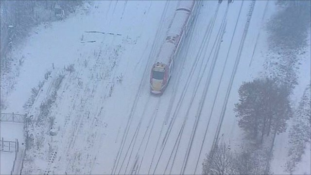 Gatwick Express train stands motionless after heavy snowfall