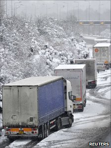 Lorries parked on the hard shoulder of the M25 motorway near Reigate