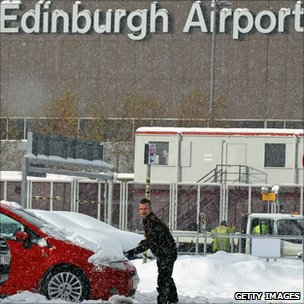 Man digs car out at Edinburgh Airport