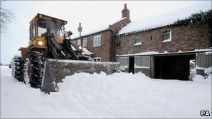 Snow being removed from a rural house outside York