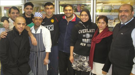 Abdul Arain, the manager of the Al-Amin Deli, and his multi-lingual staff