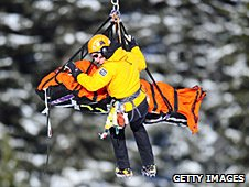 Chemmy Alcott is helicoptered off the mountain
