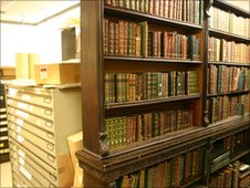 The original bookcase sits in the archive