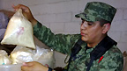 Mexican soldier inspects seized drugs