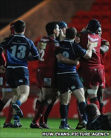 Scarlets and Leinster players exchange blows as a fight breaks out between rival players in the first-half after Sean O'Brien's late challenge on Dan Newton