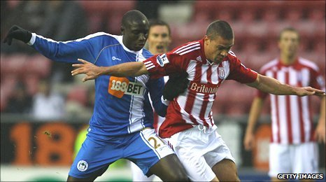 Mohamed Diame holds off the challenge of Stoke's Jon Walters