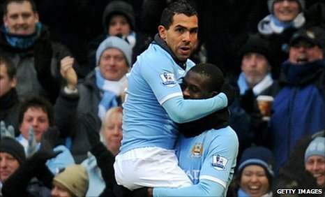 Carlos Tevez celebrates with Yaya Toure after putting City ahead