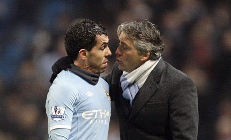 Manchester City striker Carlos Tevez and manager Roberto Manini