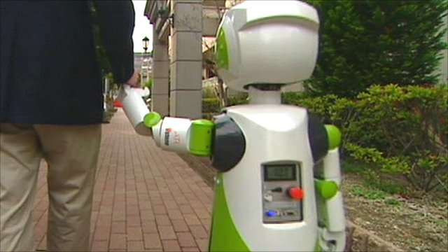 Walking hand-in-hand with a robot in Japan