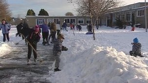 Parents clearing snow at Carrick Knowe Primary