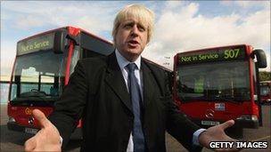 Boris Johnson and two buses