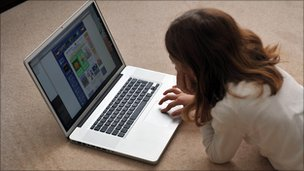 A young girl browses the internet