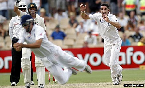 Alistair Cook (left) takes the catch as Kevin Pietersen (right) celebrates