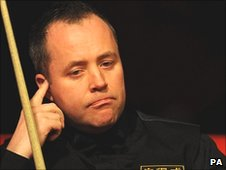 John Higgins sits in his chair during his victory over Stephen Lee