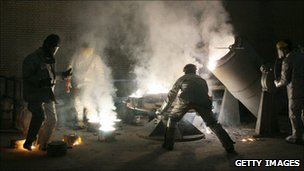 Men work inside of an uranium conversion facility March 30, 2005