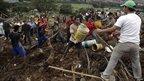 Rescuers, soldiers, policemen and locals remove rubble in Bello