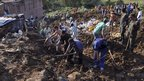 Police and residents dig at the site