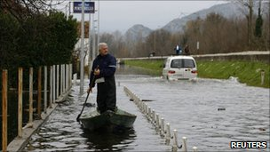 A man paddles a boat in Bistrica, Montenegro (6 Dec 2010)