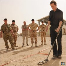 David Cameron uses a metal detector