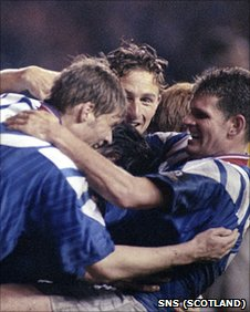 Mark Hateley (centre) is mobbed by his Rangers team-mates after equalising for the home side